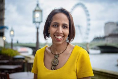 Munira standing in front of the London Eye