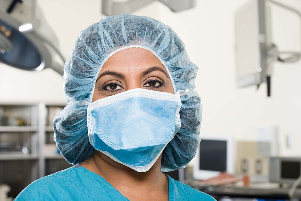 Nurse wearing a face mask and a hair net